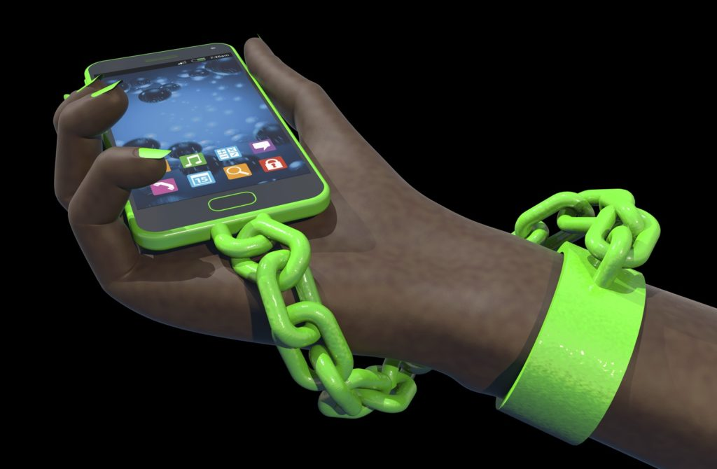 Hand chained to a smart phone